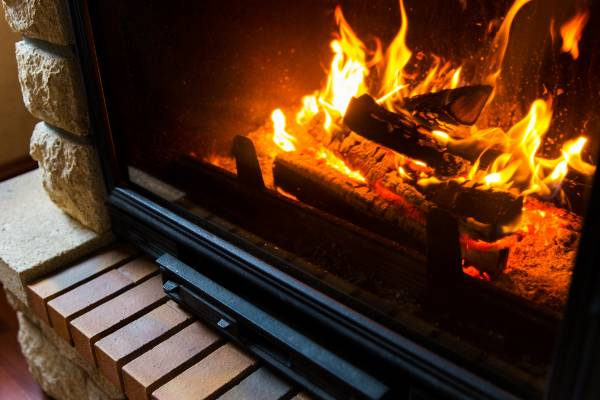heating, warmth, fire and cosiness concept - close up of burning